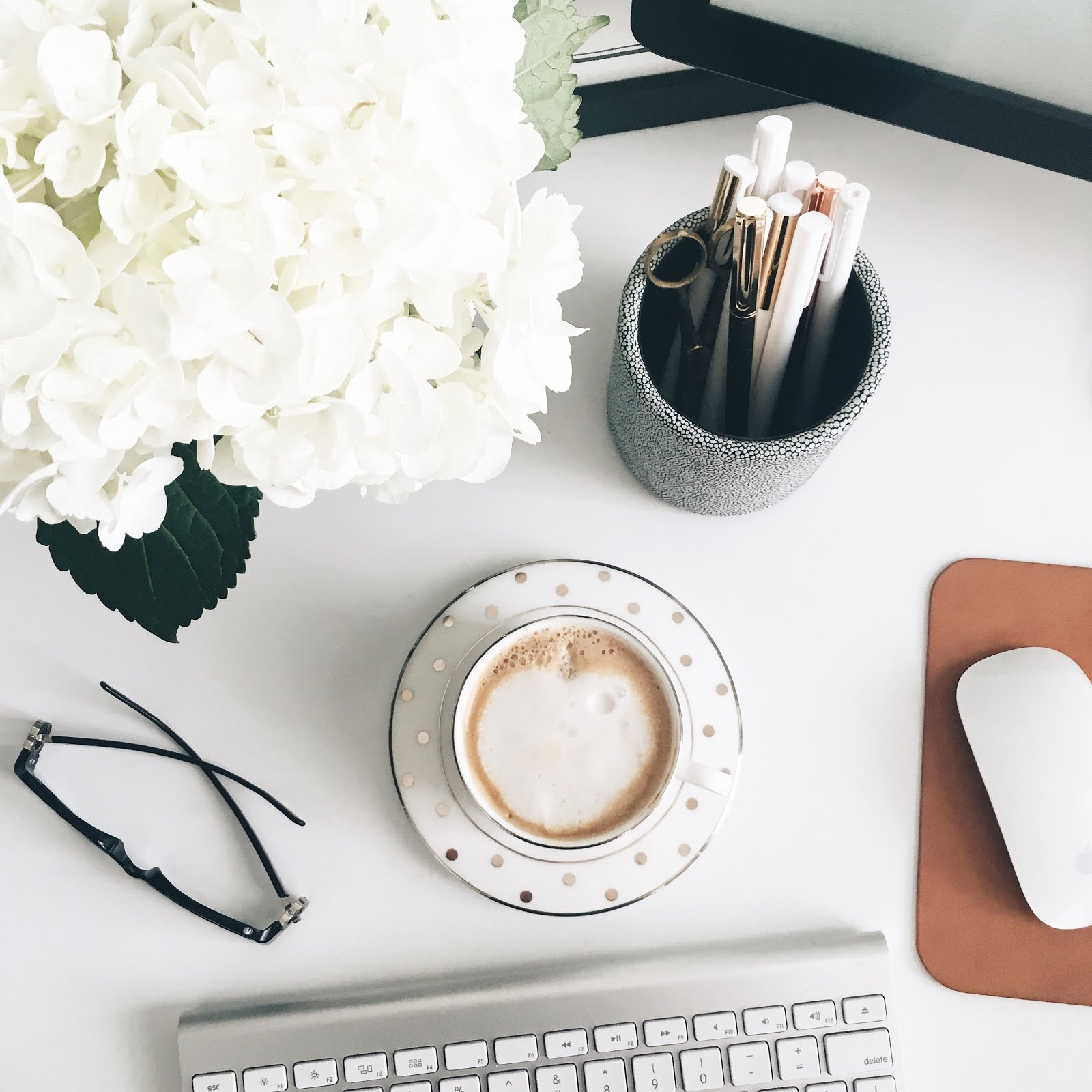 Ravacholle Lifestyle Blog | How to work with brands Danielle Moss desk the every girl my thoughts on working with brands and why you should not work for free blog cup of coffee on a pretty white desk cup and saucer from kate spade
