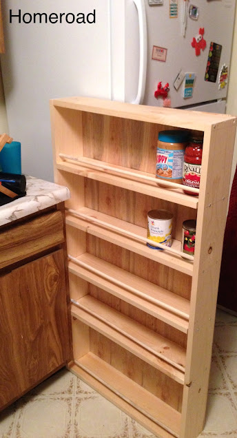 Slide out storage in a small kitchen between the fridge and the sink