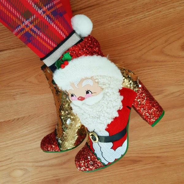 foot wearing Santa Claus applique furry glitter sequins ankle boot