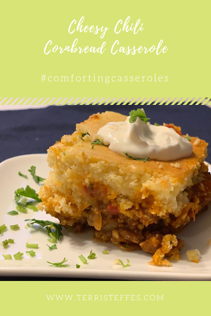 Warm Cheesy Chili Cornbread Casserole on a white dish.