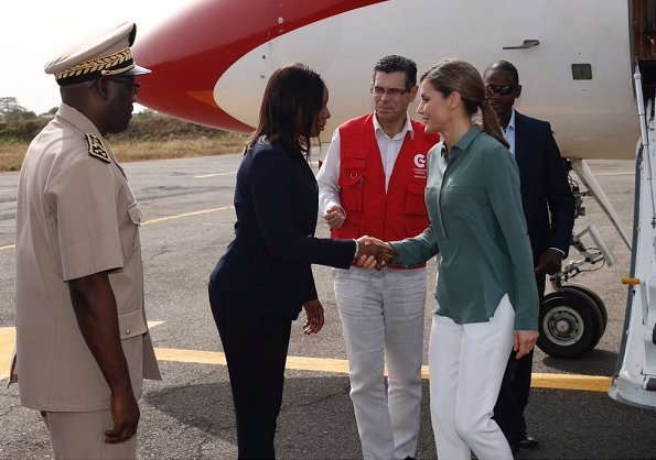 Queen Letizia wore Hugo Boss trousers, Hugo Boss blouse and Adolfo Dominguez shoes winter collection