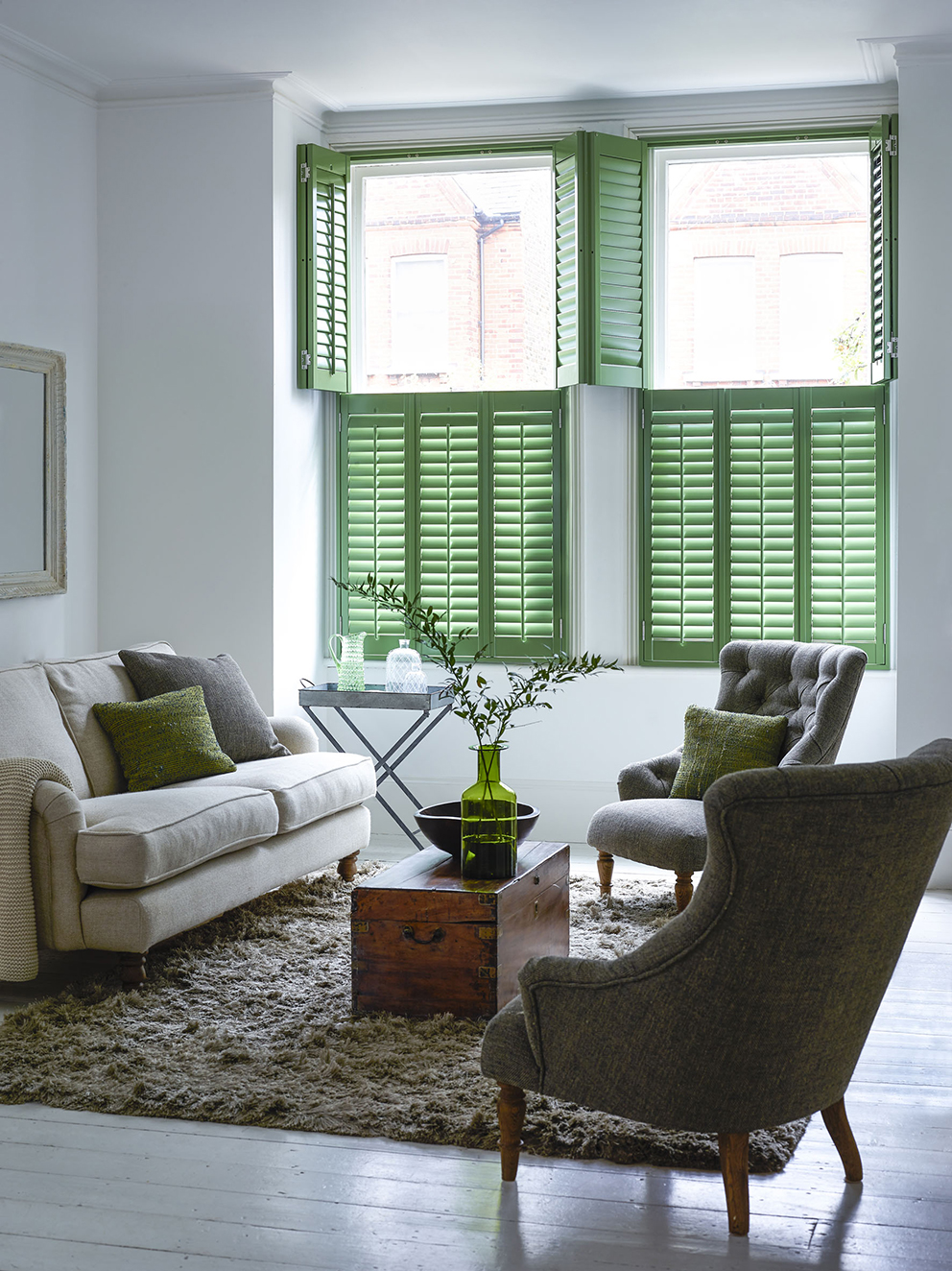 Shutterly Fabulous - French For Pineapple Blog - green tier on tier plantation shutters in neutral living room