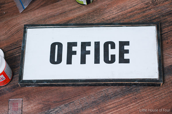 A $3.00 Goodwill sign gets repurposed into the perfect office decor.- www.littlehouseoffour.com
