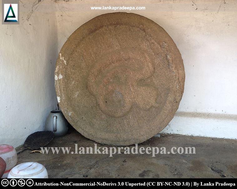 A circular artifact containing a cobra figure, Galmaduwa temple, Ampara