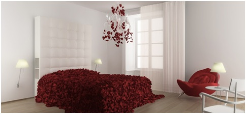 White bedroom with bedspread made of red rose petals
