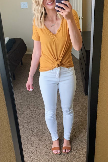 White jeans with a mustard yellow top