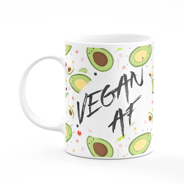 A white mug with avocados on it and 'Vegan AF' written on top.