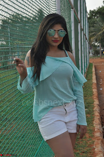 Madhulagna Das looks super cute in White Shorts and Transparent Top 08.JPG