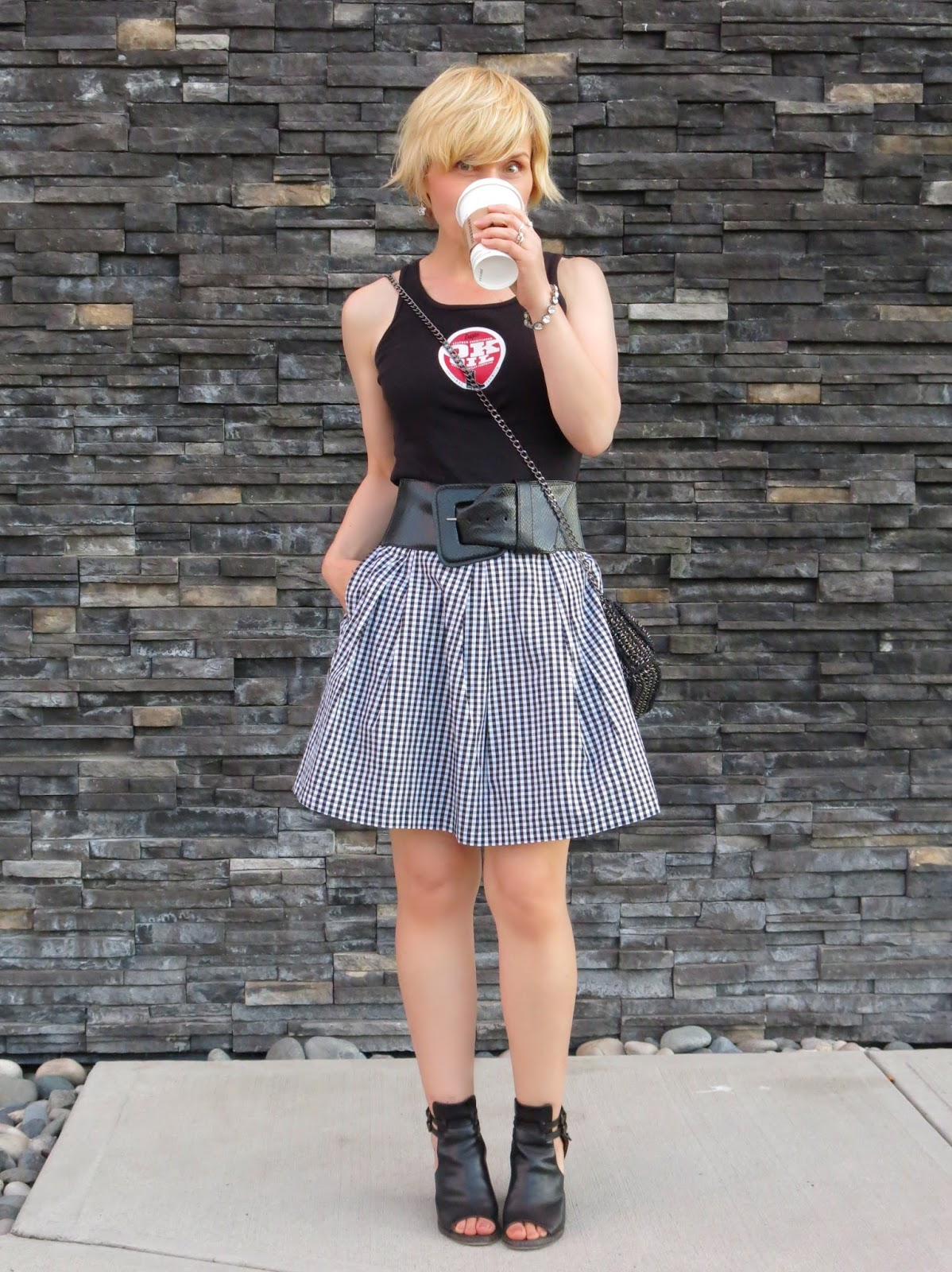 styling a black-and-white gingham skirt with a Dayton tank, extra-wide belt, and cut-out booties