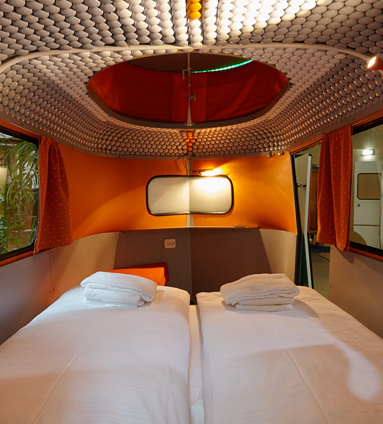 14 Crazy Hotels That Will Give You Serious Travel Goals - Caravan Hotel in Berlin, Germany is like camping for people who aren't really into experiencing the elements: It's camping quarters, but it's all indoors.