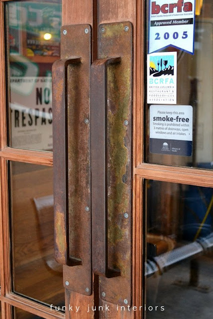 Rusty door pulls at Mission Springs Brewing Company, a junk-filled pub and restaurant.