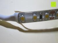 vorne: LIHAO 5M LED Strip Warmweiß 600 SMDs Band wasserdicht Streifen mit Hohlbuchse+Netzteil DC 12V Trafo Set [Energieklasse A]