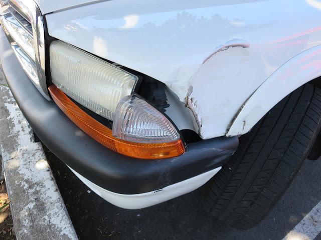 Collision damage on front corner of Dodge Dakota.