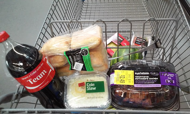 shopping basket with Coke, rolls, coleslaw, rotisserie chicken in deli