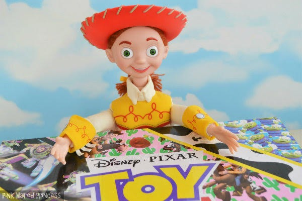 Jessie doll from Disney Toy Story wearing cowgirl hat with arms outstretched over shoe box