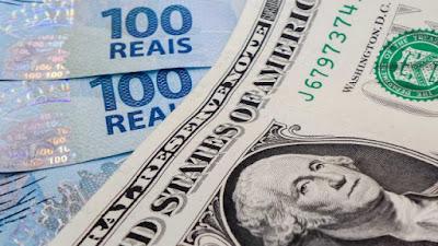 Dólar sobe mais de 1% e vai a R$ 3,70, com feriado nos EUA e greve dos caminhoneiros