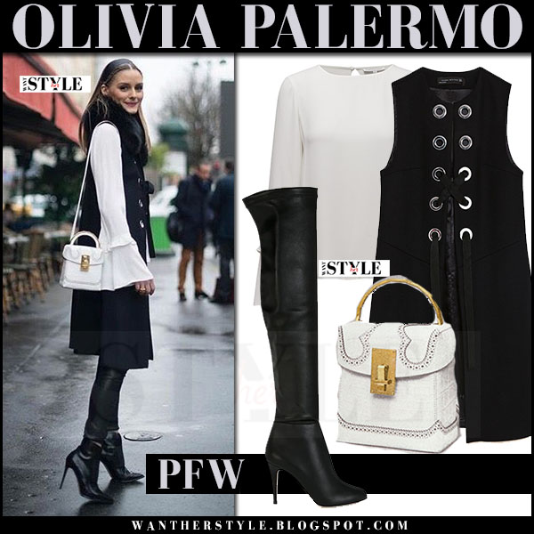 Olivia Palermo in black sleeveless zara coat, white rebecca minkoff shanaya blouse, black leather boots jimmy choo with white bag the volon what she wore paris fashion week outfits 2017