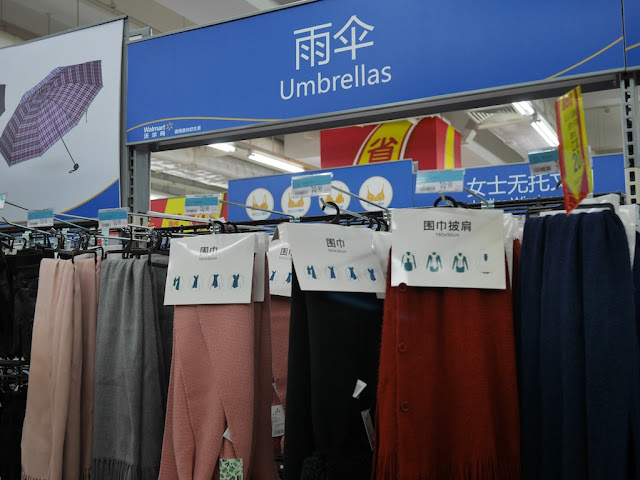 "scarves on display under an ""umbrellas"" sign at a Walmart in Zhongshan"