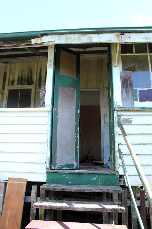 Crazy House Capers Reno Cottage Veranda Before