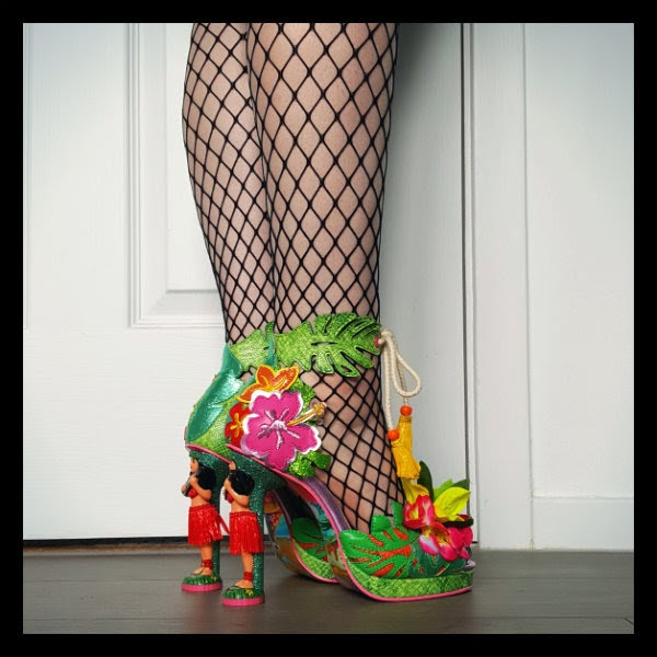 side angled legs in fishnets with hula girl heeled colourful shoes