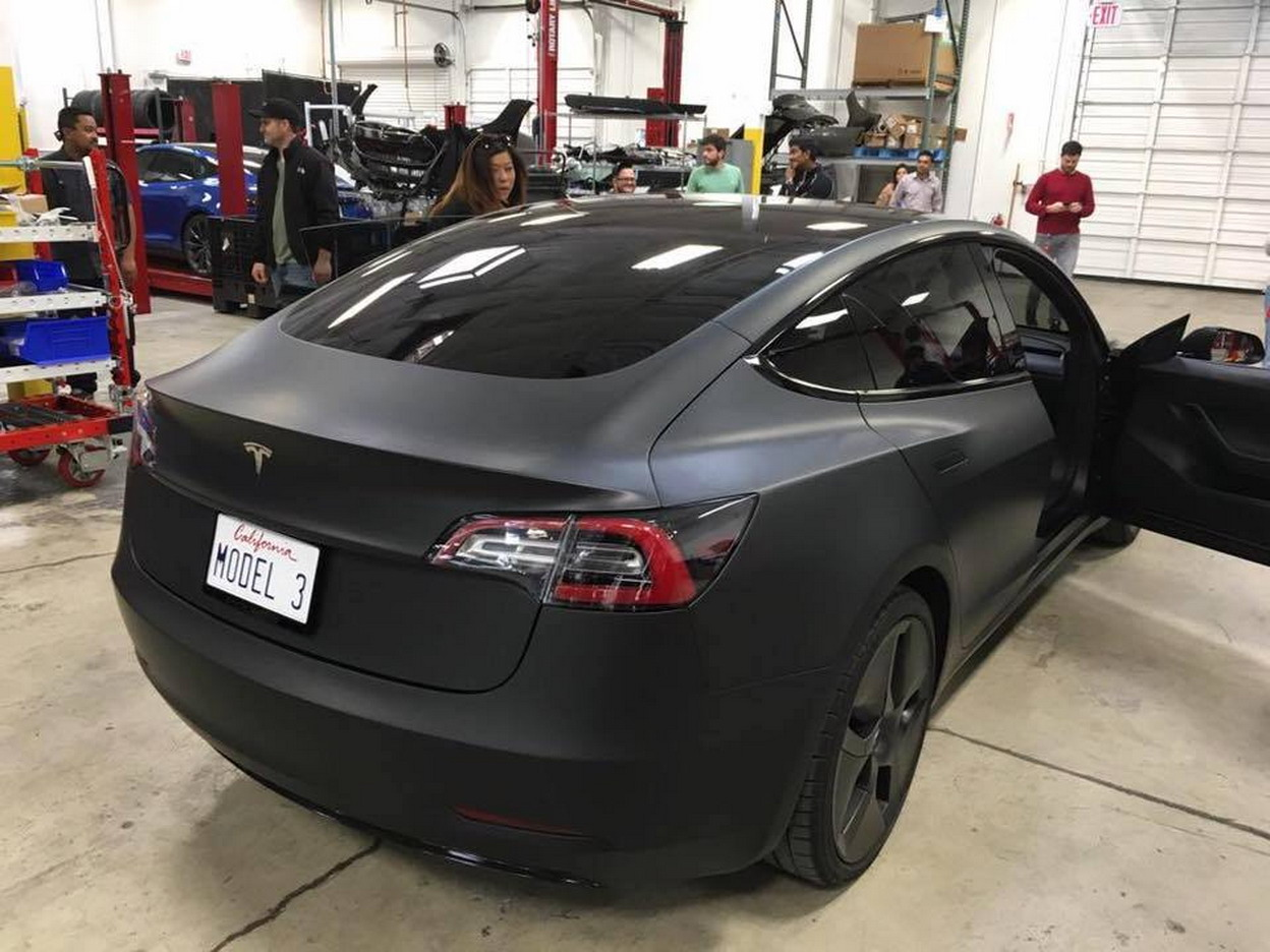 tesla model 3 prototype caught hanging out at service center carscoops. Black Bedroom Furniture Sets. Home Design Ideas