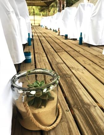 Thatch Haven deck with succulent in glass jar