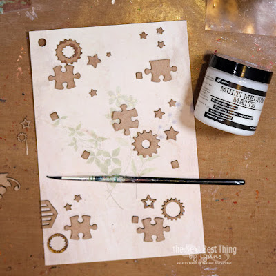Step One UmWowStudio Chipboard applied to art journal page