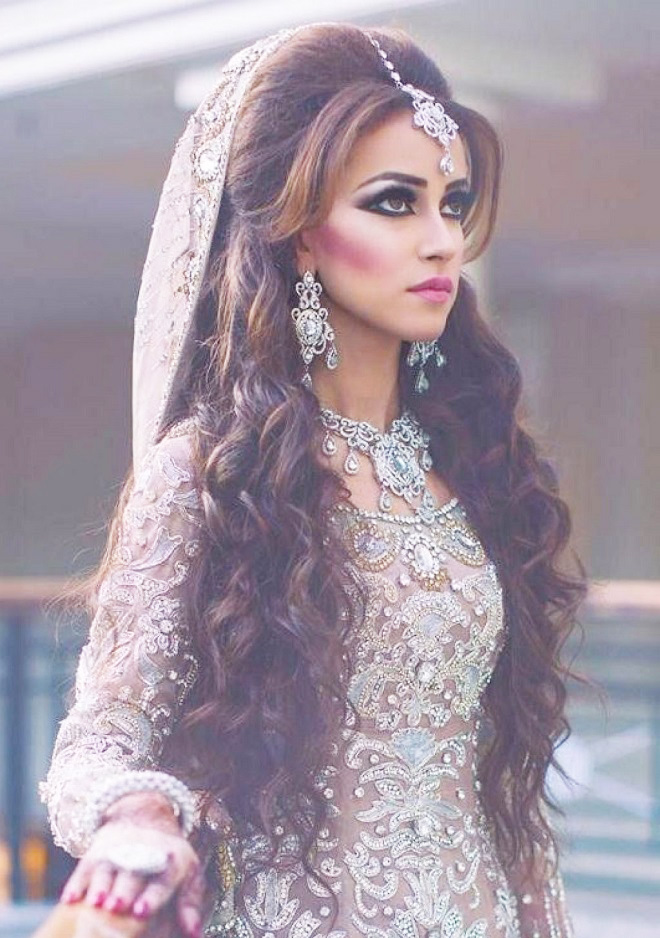 Beautiful indian bridal hairstyles for long hair this is the easiest bridal hairstyle which is perfect for any sangeet ceremony the overall look with the hairstyle can be enhanced by simply adoring a junglespirit Images