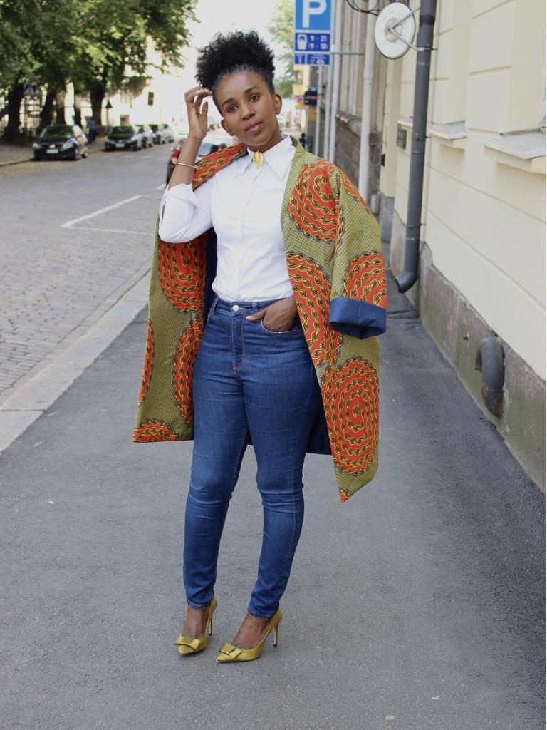 liz ndegwa wearing her infamous coat