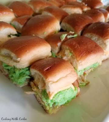 platter of small sliders with green eggs and ham in them