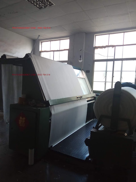 Inspection machine for long plush fabric