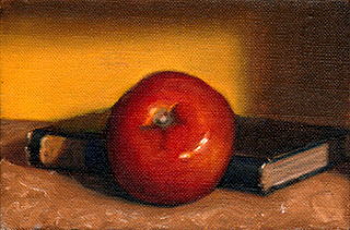Oil painting of a red tomato beside an old blue book.