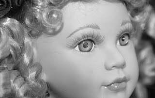 Doll With Dollar Bill Eye
