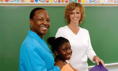 NAMC increasing Parent Involvement in your Montessori school teacher and parent talking