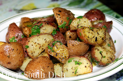 Open roasted red potatoes, tossed with olive oil and herbs and finished with melted butter and fresh parsley.