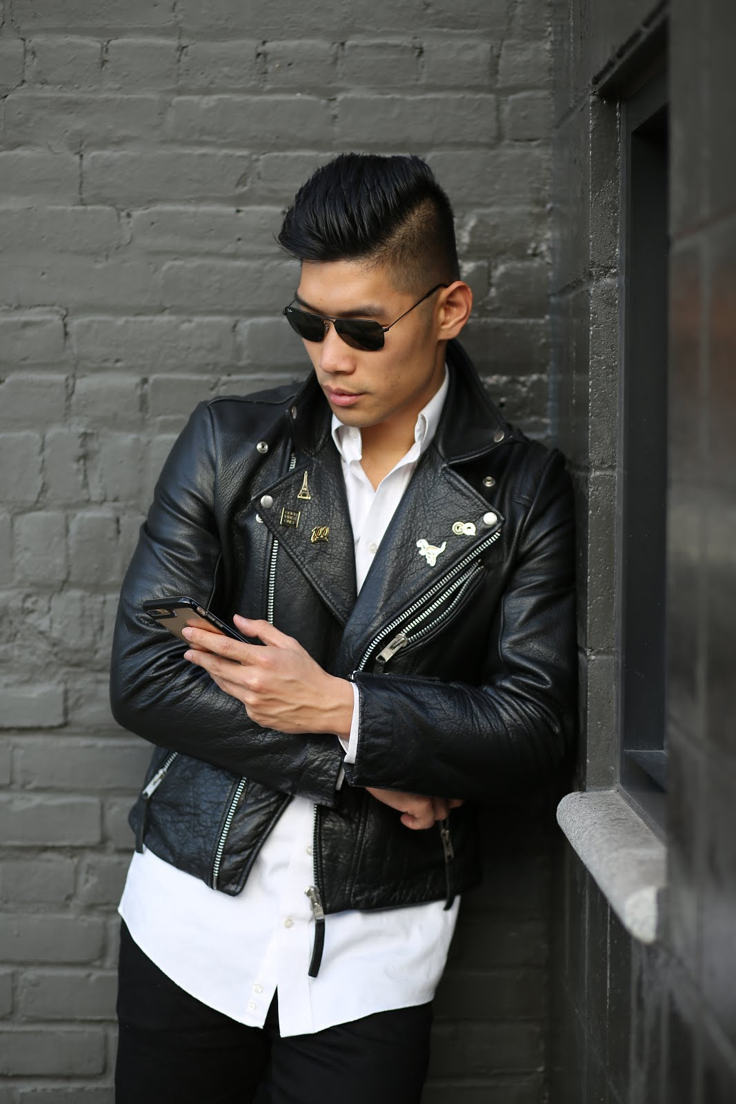 Levitate Style menswear blogger wears leather jacket with pins
