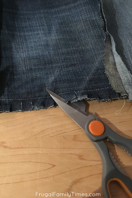 trimming edges of denim quilt