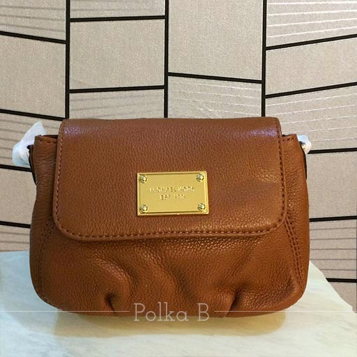 4423fcb42e3e Michael Kors Small Flap Leather Crossbody Bag. Brown pebbled leather  Exterior