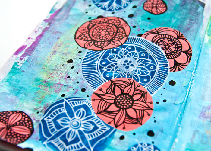 close up of an Easy art journal page with Mandala art and a video by Kim Dellow