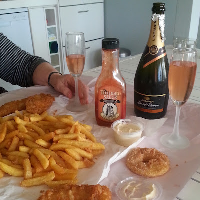 Fish and chips and a bottle of sparkling wine.