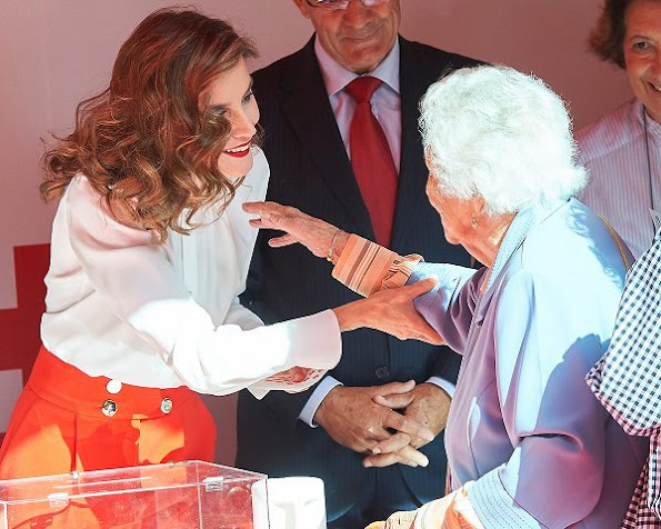 Queen Letizia at Red Cross charity Day. Queen wore Hugo Boss blouse, Hugo Boss red trousers, Adolfo Dominguez clutch, Mango shoes