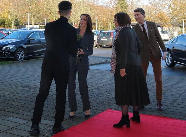 Princess Marie wore Maje Vanda plaid blazer and Maje Panda glen plaid trousers. Jimmy Choo pumps. Prince Henrik's literary works