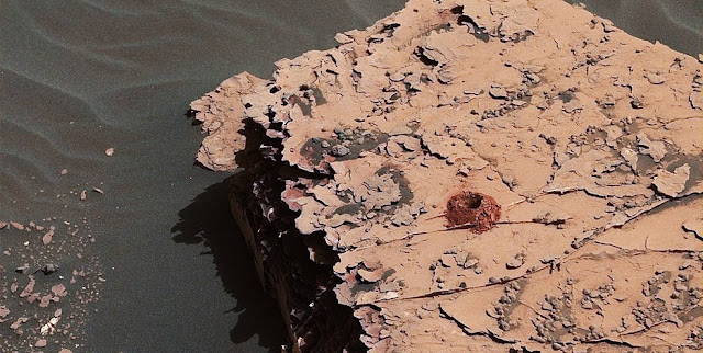 "NASA's Curiosity rover successfully drilled a 2-inch-deep hole in a target called ""Duluth"" on May 20. It was the first rock sample captured by the drill since October 2016. This image was taken by Curiosity's Mast Camera (Mastcam) on Sol 2057. Credits: NASA/JPL-Caltech/MSSS"