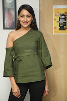 Pragya Jaiswal in a single Sleeves Off Shoulder Green Top Black Leggings promoting JJN Movie at Radio City 10.08.2017 072.JPG