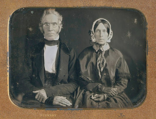 Vintage photo. An older Victorian couple looking severe. The Gentleman sports a faux-hawk and wire rim glasses. Marriage, A Word to Women by Mrs. C. E. Humphry, 1898. marchmatron.com