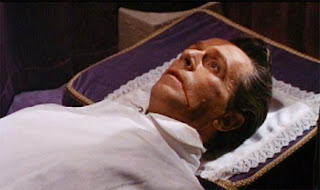 Dr. Ravna (Noel Willman) sleeps the sleep of the undead