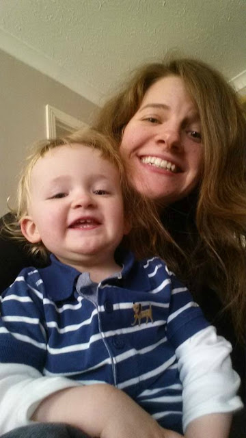 Toddler and Aunty selfie both saying cheese