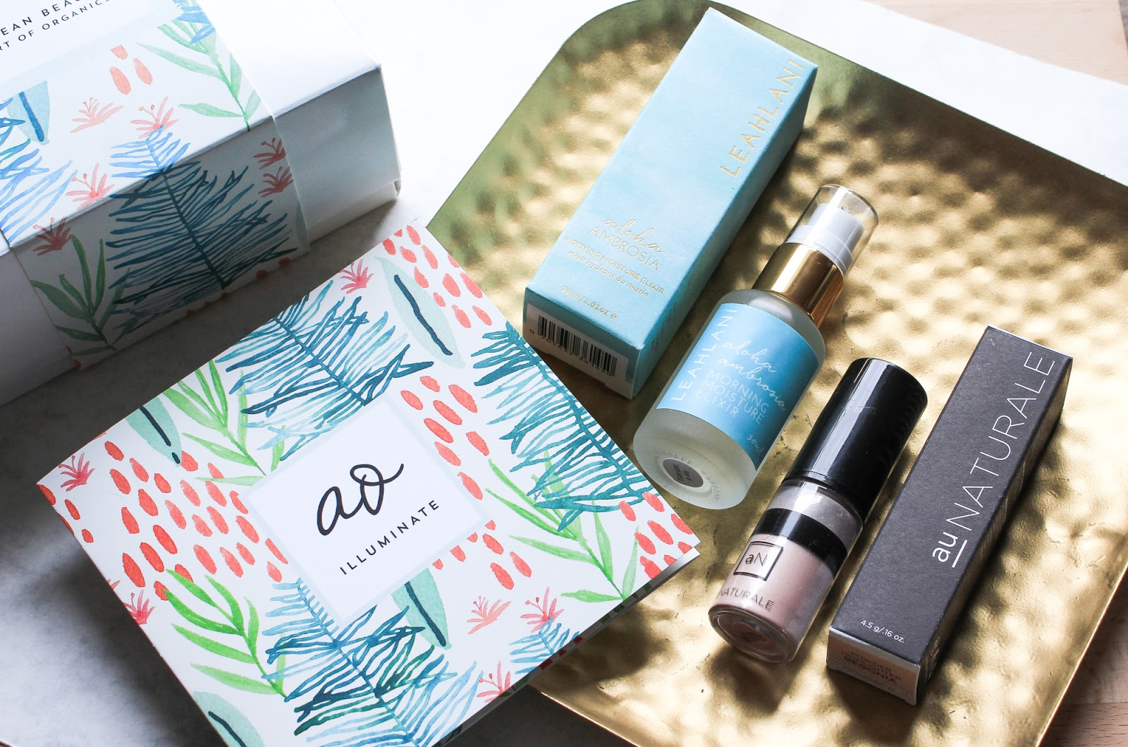 ILLUMINATE Art of Organics July 2018 Clean Beauty Box Leahlani Skincare Aloha Ambrosia Morning Moisture Elixir, Au Naturale Pure Powder Highlighter Begonia