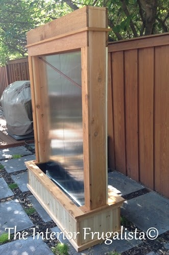 Trim top of DIY Outdoor Water Wall with cedar
