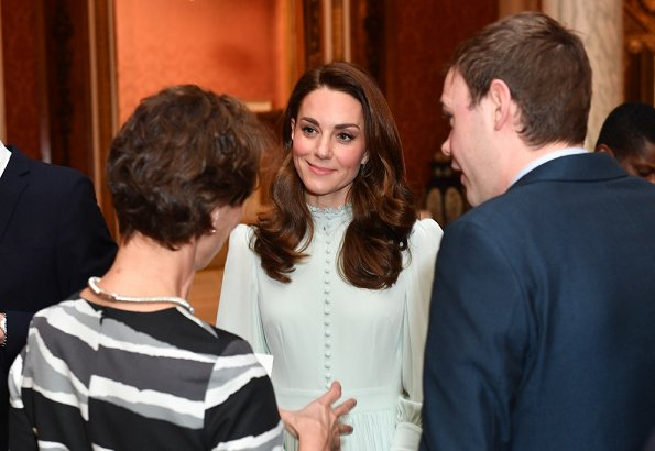 Meghan Markle wore  Amanda Wakeley coat, Kate Middleton is wearing a midi dress with ruffle detail